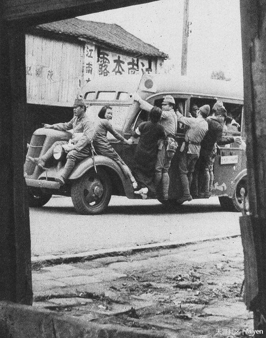 Japanese soldiers ride bus with civilians in Guangdong, China 1938.jpg