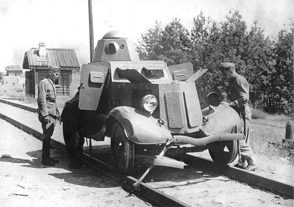 1941 Russia, Two German soldiers meet a Soviet armored car BA-20 Broneavtomobil 20 modified to travel on rails.jpg