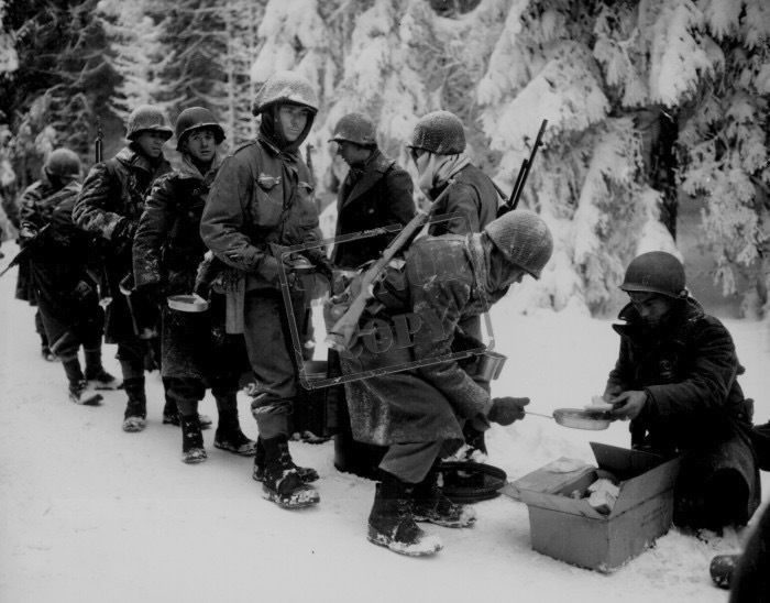 Chow is served to American Infantrymen on their way to La Roche, Belgium. 347th Infantry Regiment. Newhouse, January 13, 1945.jpg