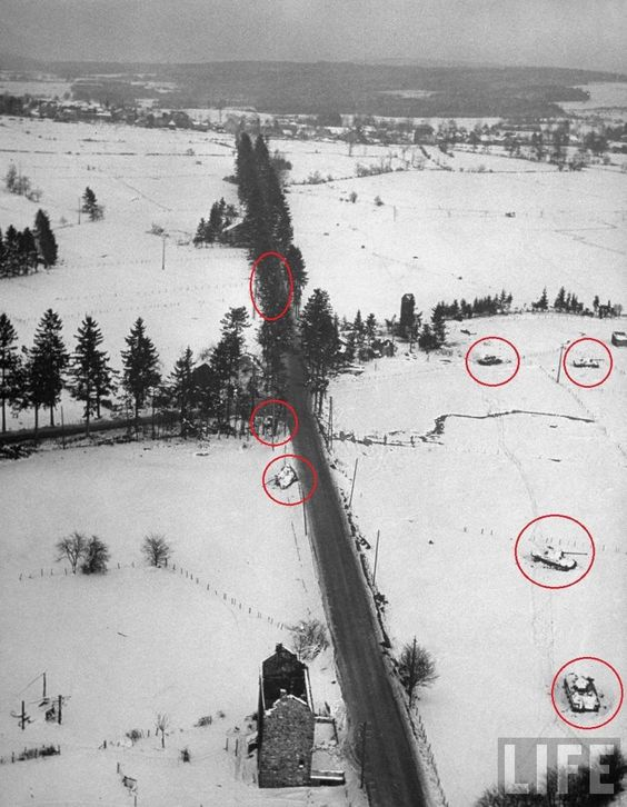 Four Panthers from the 4th SS-PzRgt 2 Das Reich immobilized in a minefield, and three more were knocked out near the main road. Battle of the Bulge in the Ardennes.jpg