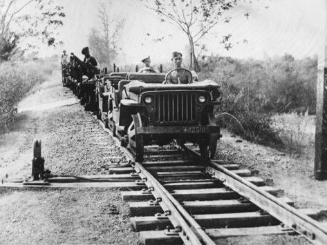 Jeep locomotive pulling supply train Burma 43.jpg