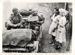 1944- U.S. soldiers ride in their jeep on an egg hunting expedition.jpg