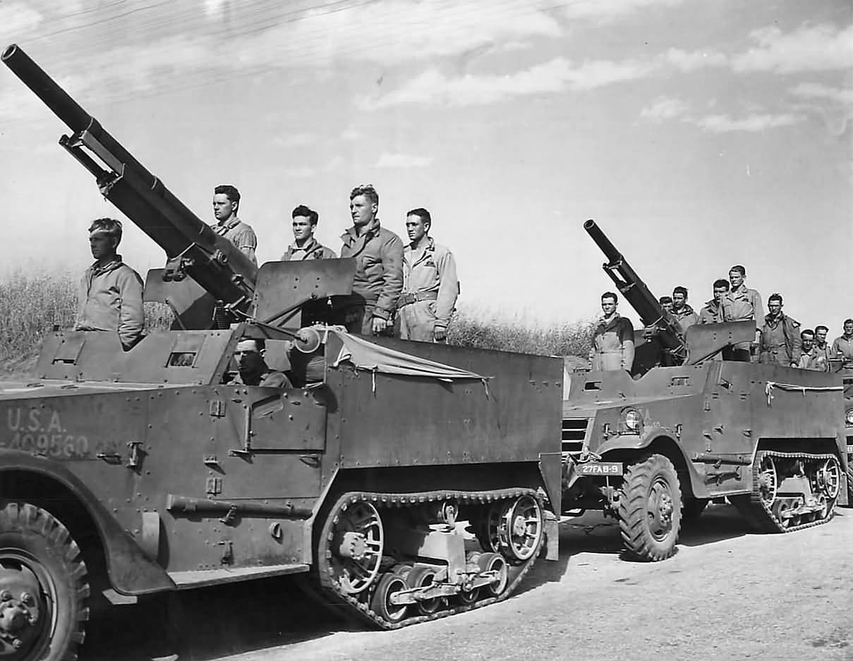 US SPG T12  75mm_GMC_M1897A4_M3  27th_Field_Artillery_Troops.jpg