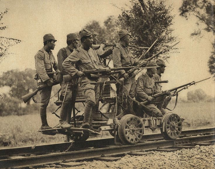 Japanese Draisine Army soldiers with Arisaka Type 38 rifles on a hand cart, China, 1937.jpg