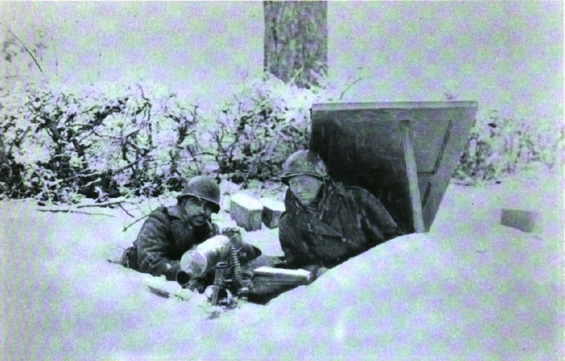 US - Machine gun under snow - Battle of the Bulge - 84th Inf Div - Battle of Germany.JPG