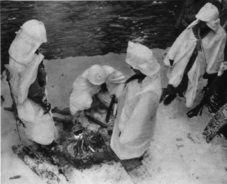 US - GI boil water under snow - Battle of the Bulge - 84th Inf Div - Battle of Germany.JPG