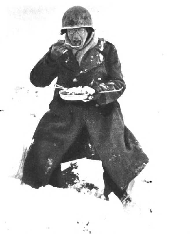 US - GI eating under snow - Battle of the Bulge - 84th Inf Div - Battle of Germany.JPG
