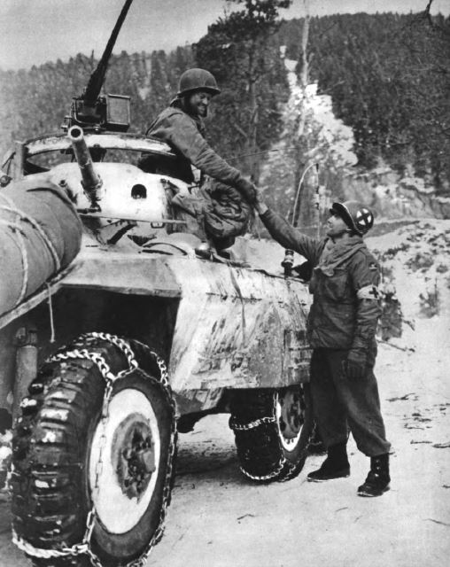 US - Armored car - M8 Greyhound OF 11th Armoured Division with medic of 84th inf div - Battle of the Bulge - 84th Inf Div - Battle of Germany.JPG