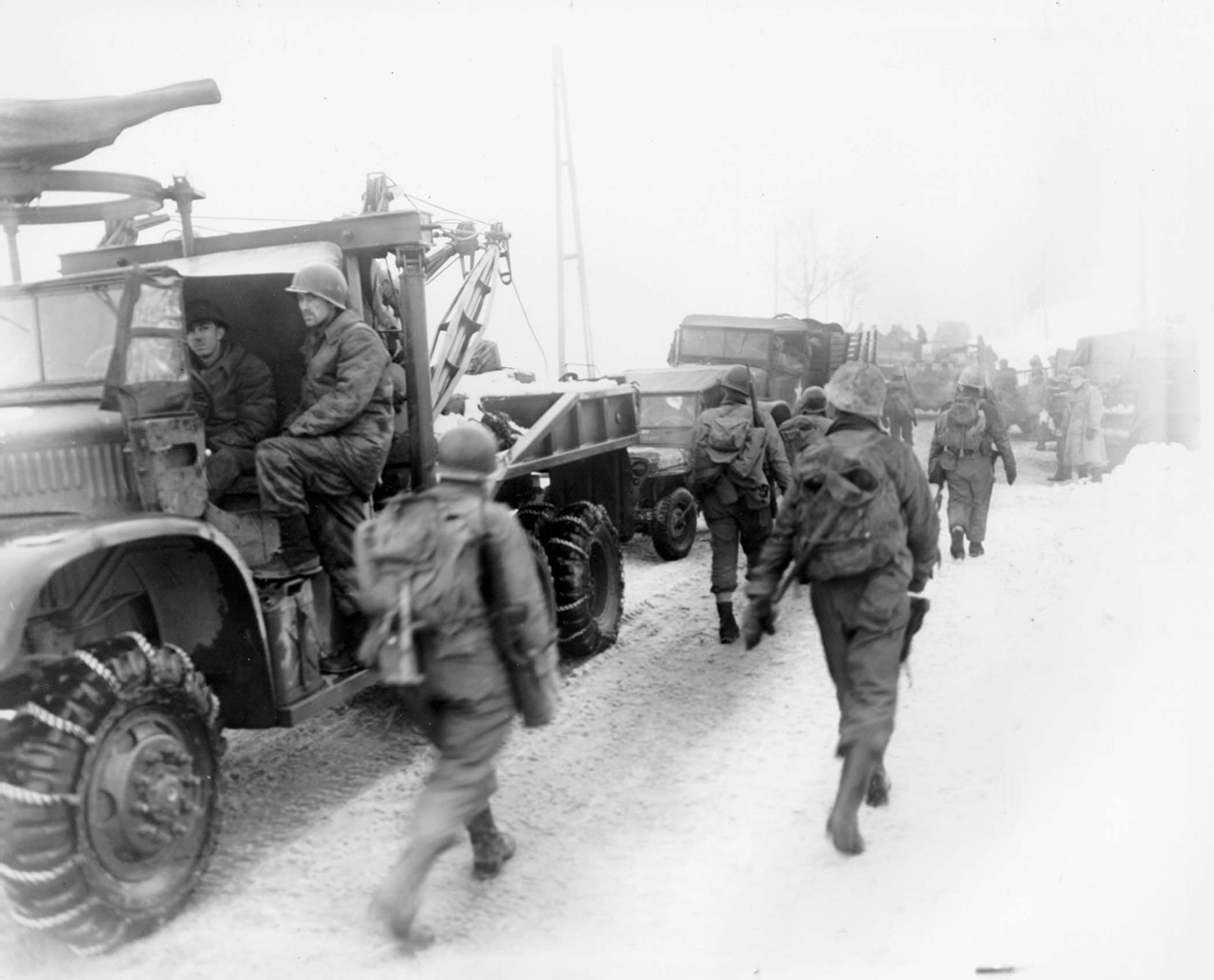 US Trucks Soldiers of Infantry Regiment Infantry Division move towards Murrigen after continously fighting for 47 days during the Battle of the Bulge.jpg