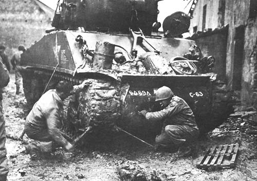 REPLACING TRACKS ON A SHERMAN TANK.jpg