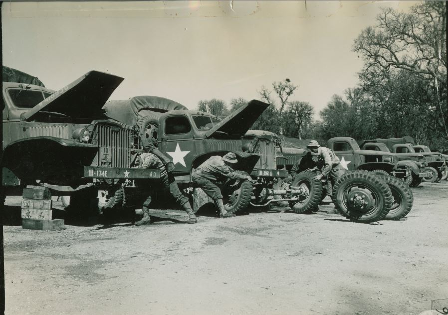 548th Ord H M Co. (FA) Repair Line 1 - 2 Ton. Vehicle on the left is to be evacuated so its front end is used to repair the other truck. Interchanging parts in this manner eliminates the necessity of deadlining 2 vehicles.JPG