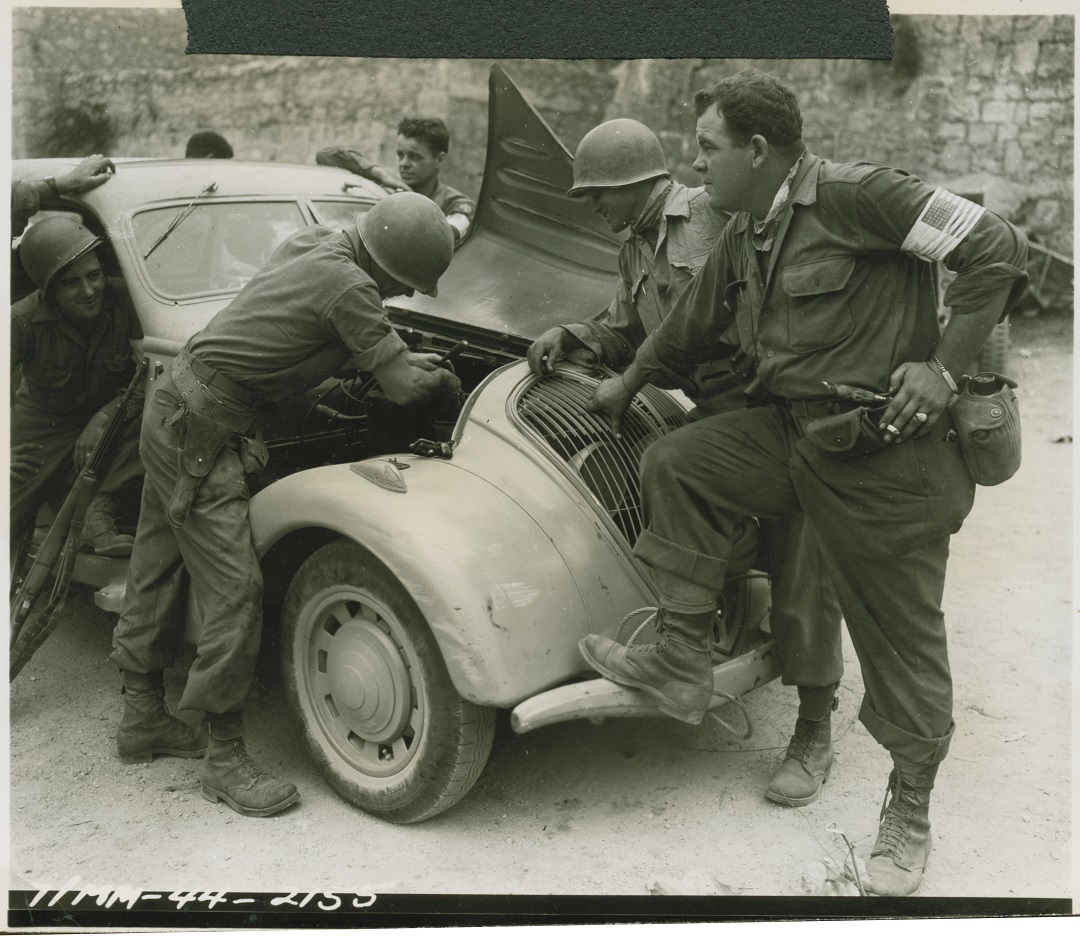 US soldier trying to repair a German car in Vidauban, France on 17 August 1944.jpg