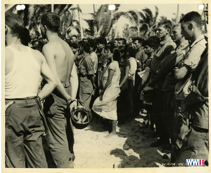 Young native population from Kwajalein Atoll at dedication ceremony after successful invasion of Kwajalein Atoll. Marshallese at memorial services on Enilapkan Island. 7 février 1944.JPG