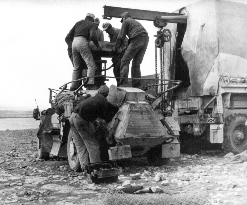 The process of dismantling the tower of the German Intelligence bronemavtomobilya Sd. Kfz. 222 works are carried out with the help of a truck repair shop, equipped with a winch..jpeg