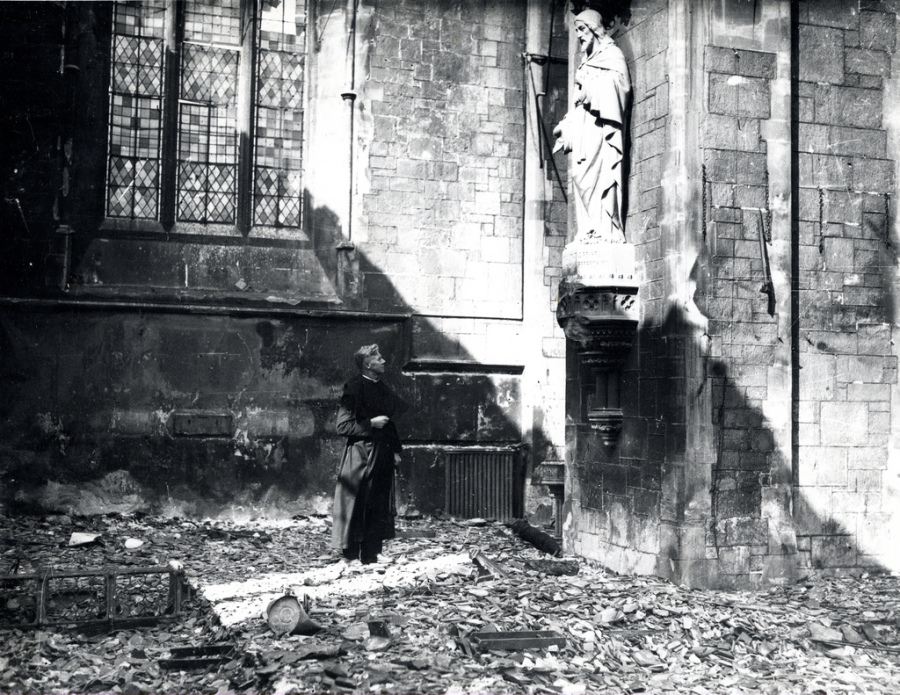 Plymouth  The Rural Dean, Rev. G. B. Hardy inside St Peter's after the 21-22 April 1941 raid.jpg