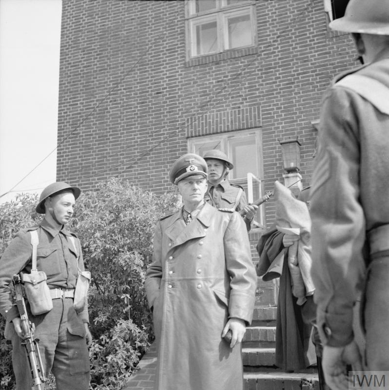 1st Battalion, The Cheshire Regiment enter the 'Sportschule' in Mürwik, a few miles from Flensburg, in which members of the German Government were sheltering, 23 May 1943_ Jold.jpg