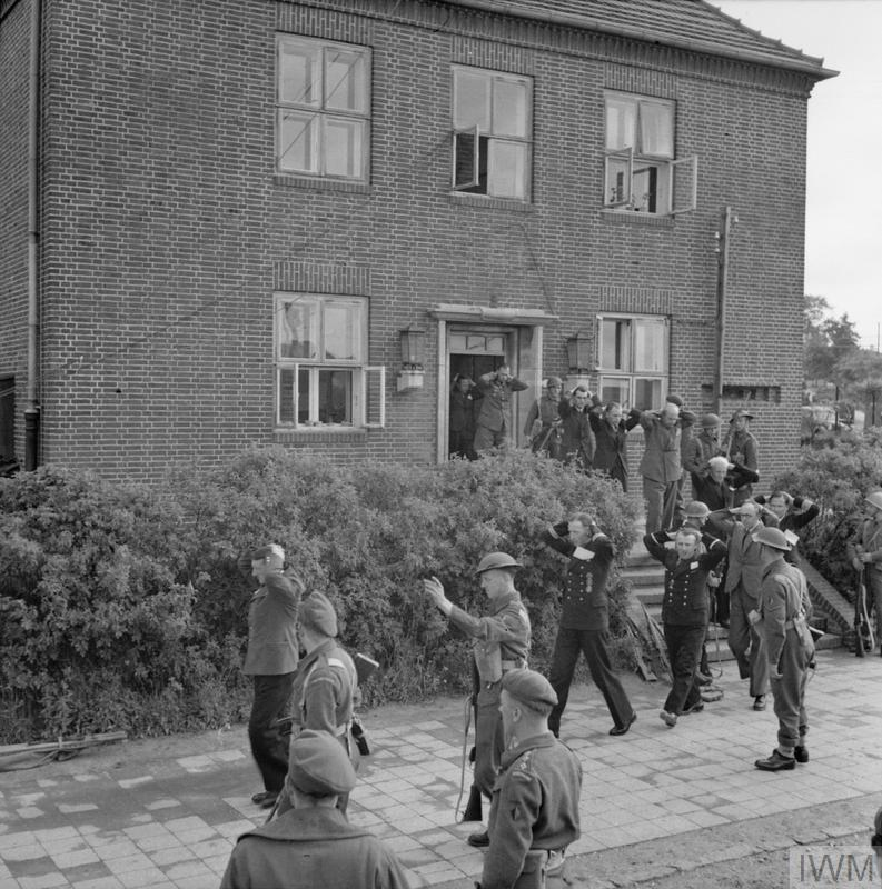 1st Battalion, The Cheshire Regiment enter the 'Sportschule' in Mürwik, a few miles from Flensburg, in which members of the German Government were sheltering, 23 May 1943_2.jpg