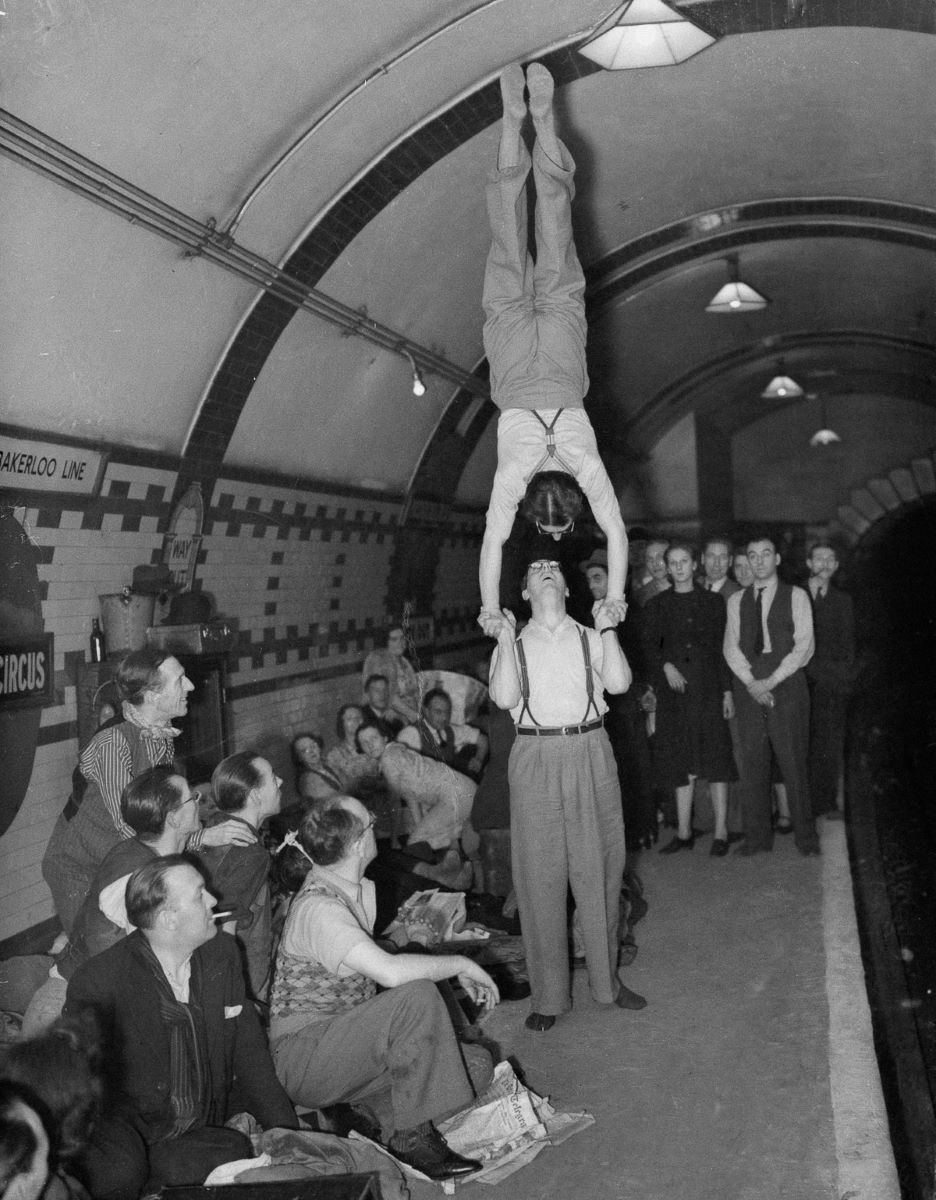 The Storre Brothers, a pair of music hall artistes, entertain their companions underground.jpg