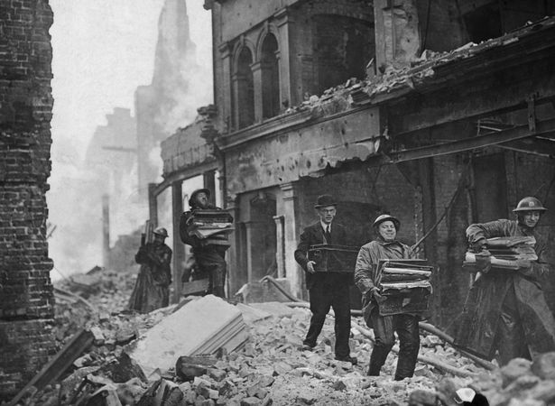 People salvaging books and papers from bombed out offices in London during The Blitz.jpg