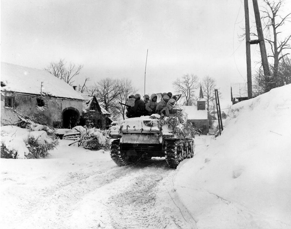 [Photo] Men of Company I, 3d Battalion, 16th Infantry Regiment, US 1st Division riding on M4 Sherman tank at Schopen, Belgium, 21 Jan 1945.jpg
